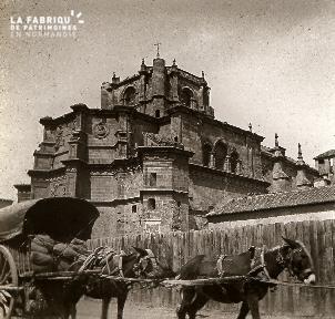 B041 chariot tiré par deux ânes et monument religieux
