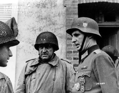 Entretien entre un capitaine allemand prisonnier et deux soldats américains